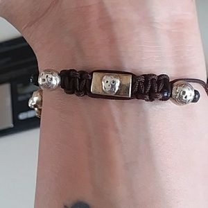 Gold skull bracelet.
